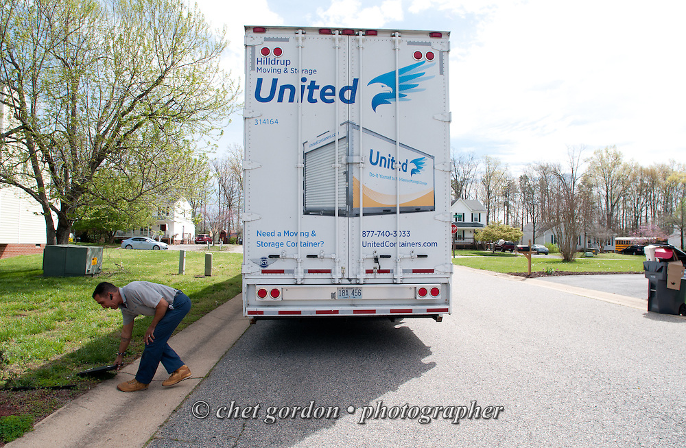 Over the road truck driver Jose Williams outside a shipper's home in Midlothian, VA on Thursday, April 16, 2015. Williams, a cross country trucker with a national household moving company, will make several delivery stops in central California's Bay Area the following week with loads that originated in Virginia.  © Chet Gordon/THE IMAGE WORKS