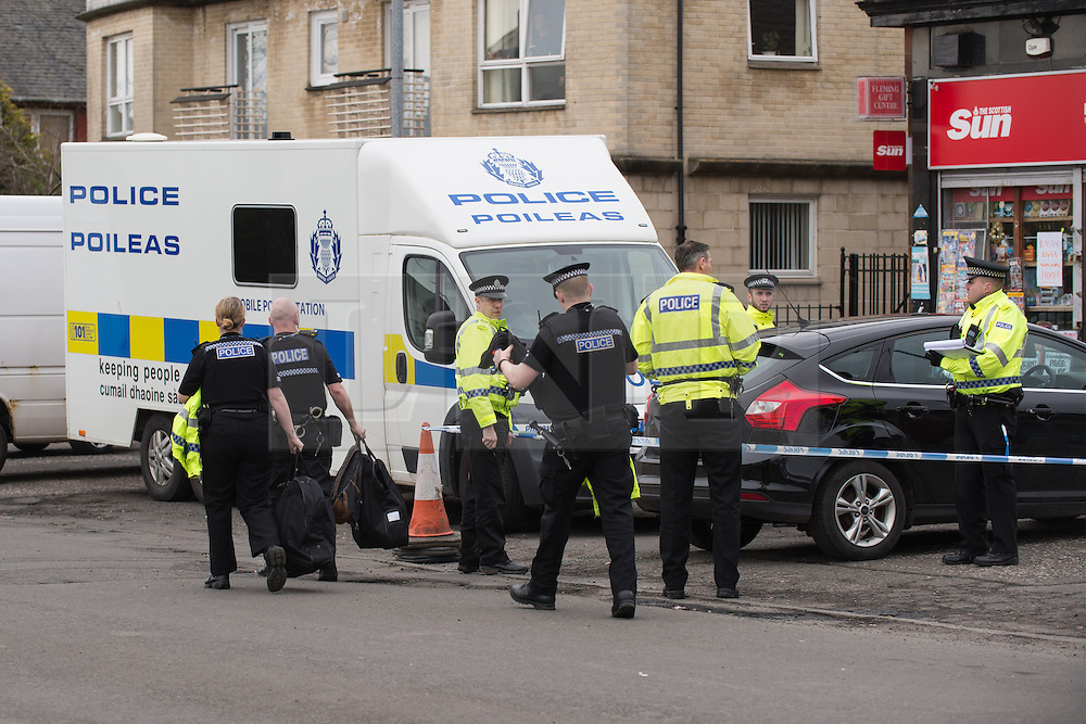 © Licensed to London News Pictures. 25/03/2016. <br /> <br /> Pictured: Police officers arrive during a handover at Delicious Deli, Clydebank. <br /> <br /> Police Scotland have focused the centre of the murder investigation of 15 year old Paige Doherty in Clydebank, Glasgow around the home and business premises of suspect John Leathem as they search his house and Delicious Deli near Fleming Street, Clydebank Glasgow on Friday 25th March 2016.<br /> <br />  Photo credit should read Max Bryan/LNP