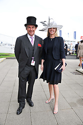KATE REARDON and CHARLIE GORDON-WATSON at the 2012 Investec sponsored Derby at Epsom Racecourse, Epsom, Surrey on 2nd June 2012.