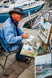 Artist working on the quayside in Honfleur, France