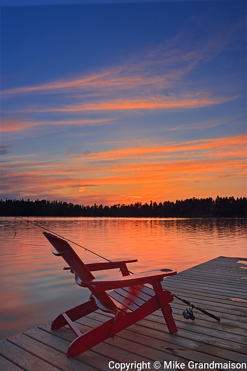 Muskoka chair  at Star Lake at sunset<br />