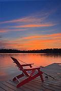 Muskoka chair  at Star Lake at sunset<br />Whiteshell Provincial Park<br />Manitoba<br />Canada