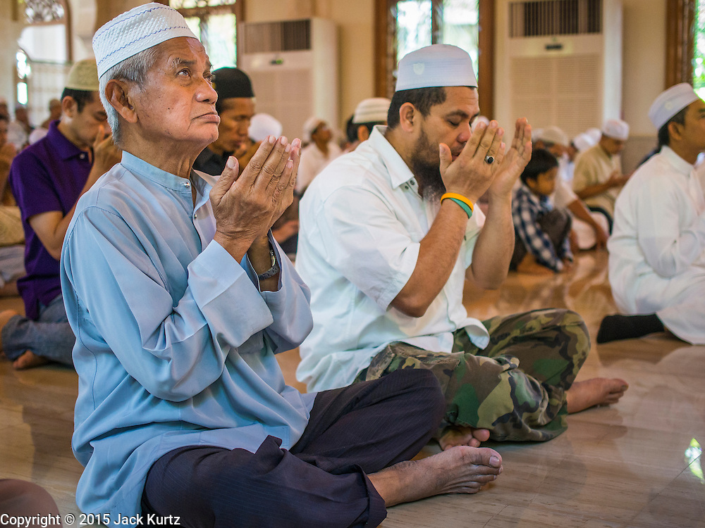 10 APRIL 2015 - BANGKOK, THAILAND: Friday mid day prayers at Masjid Ton Son in Bangkok. (Masjid is the Thai word for Mosque.) A Pew Research Center study recently released identified Islam as the fastest growing religion in the world. Masjid Ton Son was the first mosque in Bangkok, founded in 1688 during the reign of King Narai, of the Ayutthaya era. Muslims are about 5 percent of Thailand, but make up a bigger proportion of Bangkok. Thailand's deep south provinces are Muslim majority.    PHOTO BY JACK KURTZ