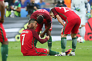 Portugal Forward Cristiano Ronaldo is down injured and is comforted by Portugal Midfielder Nani and Portugal Midfielder Adrien Silva during the Euro 2016 final between Portugal and France at Stade de France, Saint-Denis, Paris, France on 10 July 2016. Photo by Phil Duncan.
