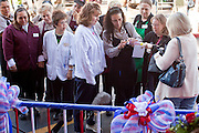 "15 JANUARY 2010 - TUCSON, AZ:    Safeway employees at a memorial for the victims of a mass shooting in Tucson, AZ,  Saturday, January 15, one week after the shooting. Six people were killed and 14 injured in the shooting spree at a ""Congress on Your Corner"" event hosted by Arizona Congresswoman Gabrielle Giffords at a Safeway grocery store in north Tucson on January 8. Congresswoman Giffords, the intended target of the attack, was shot in the head and seriously injured in the attack but is recovering. Doctors announced that they removed her breathing tube Saturday, one week after the attack. The alleged gunman, Jared Lee Loughner, was wrestled to the ground by bystanders when he stopped shooting to reload the Glock 19 semi-automatic pistol. Loughner is currently in federal custody at a medium security prison near Phoenix.  PHOTO BY JACK KURTZ"
