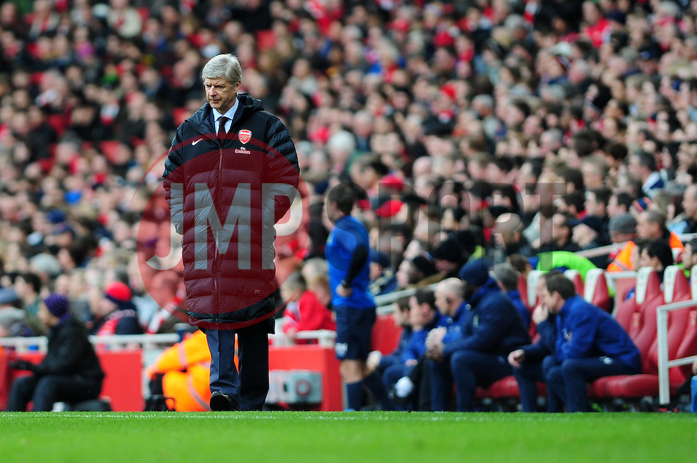 Arsenal Manger, Arsene Wenger looks aaay in disappointment after Arsenal's Gervinho misses a good chance - Photo mandatory by-line: Dougie Allward/JMP - Tel: Mobile: 07966 386802 16/02/2013 - SPORT - FOOTBALL - Emirates Stadium - London -  Arsenal V Blackburn Rovers - FA Cup - Fifth Round