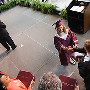 060111 Newark DE:  Hodgson Vo-Tech high Principal Annemarie Linden handing out a diploma to a  Hodgson students during graduation ceremony Wednesday, June 1, 2011 at The Bob Carpenter Center in Newark Delaware...Special to The News Journal/SAQUAN STIMPSON