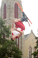 Goshen, NY - A member of the Skyriders, an acrobatic trampoline team, flips through the air while wearing skis at the Great American Weekend festival on July 5, 2008.