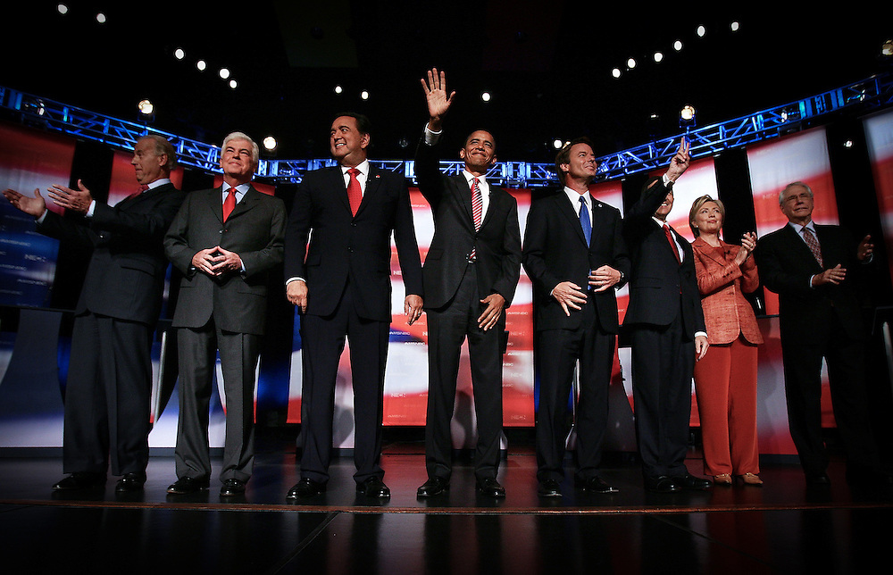 From left, Democratic presidential candidates U.S. Senator Joe Biden, U.S. Senator Chris Dodd,  New Mexico Governor Bill Richardson, U.S. Senator Barack Obama,  former U.S. Senator John Edwards, U.S. Representative Dennis Kucinich, U.S. Senator Hillary Clinton, and former U.S. Senator Mike Gravel greet the audience before their debate at Dartmouth College in Hanover, New Hampshire  September 26, 2007.