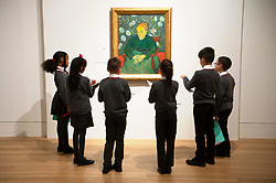 © Licensed to London News Pictures. 25/03/2019.School children from Milbank Primary Academy view a painting titled Augustine Roulin (Roxking a Cradle) (1889) by artist Vincent van Gogh. The painting is part of The EY Exhibition: Van Gogh and Britain at the Tate BritainLondon, UK. Photo credit: Ray Tang/LNP