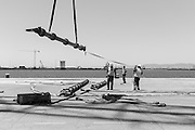 Black & White Image of the spreader beam being moved