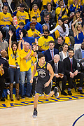 Golden State Warriors guard Klay Thompson (11) celebrates a made three pointer against the San Antonio Spurs during Game 2 of the Western Conference Quarterfinals at Oracle Arena in Oakland, Calif., on April 16, 2018. (Stan Olszewski/Special to S.F. Examiner)