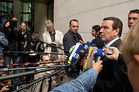 28 AUG 2004, BERLIN/GERMANY:<br /> Gerhard Schroeder, SPD, Bundeskanzler, gibt wartenden Journalisten ein kurzes Statement, vor Beginn der Klausursitzung des SPD Parteivorstandes, vor dem Willy-Brandt-Haus<br /> IMAGE: 20040828-01-017<br /> KEYWORDS: Mikrofon, microphone, Journalist, Journalisten, Pressekonferenz, Gerhard Schröder