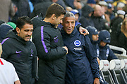 Brighton and Hove Albion manager Chris Hughton greets Tottenham Hotspur Manager Mauricio Pochettino and shares a laugh during the Premier League match between Brighton and Hove Albion and Tottenham Hotspur at the American Express Community Stadium, Brighton and Hove, England on 22 September 2018.