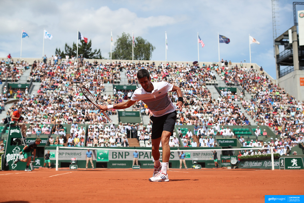 2017 French Open Tennis Tournament - Day Four.  Novak Djokovic of Serbia clams his racket down after missing a shot during his match against Joao Sousa of Portugal on Court Suzanne Lenglen in the Men's Singles second round match match at the 2017 French Open Tennis Tournament at Roland Garros on May 31st, 2017 in Paris, France.  (Photo by Tim Clayton/Corbis via Getty Images)