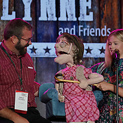 Cardinal Health RBC 2019 Entertainment Night. Darci Lynne and Friends singing to Dale Kachner (PioneerRx). Photo by Alabastro Photography.