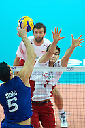 Poland's Karol Klos defends against Brazil's Sidnei Dos Santos Jr. (left) while volleyball final match between Brazil and Poland during the 2014 FIVB Volleyball World Championships at Spodek Hall in Katowice on September 21, 2014.<br /> <br /> Poland, Katowice, September 21, 2014<br /> <br /> For editorial use only. Any commercial or promotional use requires permission.<br /> <br /> Mandatory credit:<br /> Photo by © Adam Nurkiewicz / Mediasport