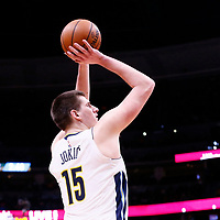 01 April 2018: Denver Nuggets center Nikola Jokic (15) takes a jump shot during the Denver Nuggets 128-125 victory over the Milwaukee Bucks, at the Pepsi Center, Denver, Colorado, USA.