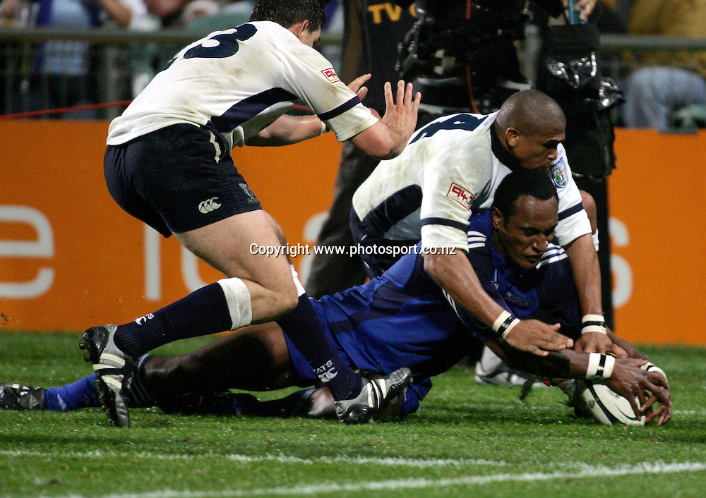 Eddie Fredericks prevents Joe Rokocoko from scoring during the Rebel Sport Super 12 Round Seven match between the Blues and the Cats at North Harbour Stadium, Auckland, New Zealand on Saturday 9th April 2005. The Blues won the match, 23 - 6. Photo: Hannah Johnston/PHOTOSPORT