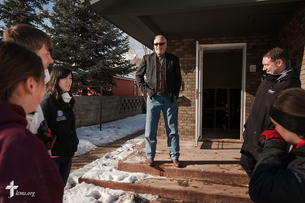 The Rev. Paul Rhode of Eternal Savior Lutheran Church chats with a group of students from Mt. Calvary Lutheran Student Fellowship at South Dakota State University, outside of a flood-damaged home in Lyons, Colo., on Wednesday, Jan. 8, 2014.  On the far right is the Rev. Michael W. Meyer, manager of LCMS Disaster Response. LCMS Communications/Erik M. Lunsford