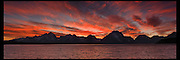 Fiery sunset over Jackson Lake and the Teton mountain range in Grand Teton National Park.