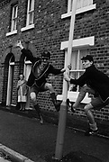 Two members of Madness outside a house in school uniform. UK 1980s