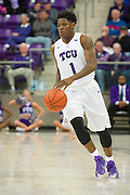 FORT WORTH, TX - FEBRUARY 6: Chauncey Collins #1 of the TCU Horned Frogs brings the ball up court against the Kansas Jayhawks on February 6, 2016 at the Ed and Rae Schollmaier Arena in Fort Worth, Texas.  (Photo by Cooper Neill/Getty Images) *** Local Caption *** Chauncey Collins