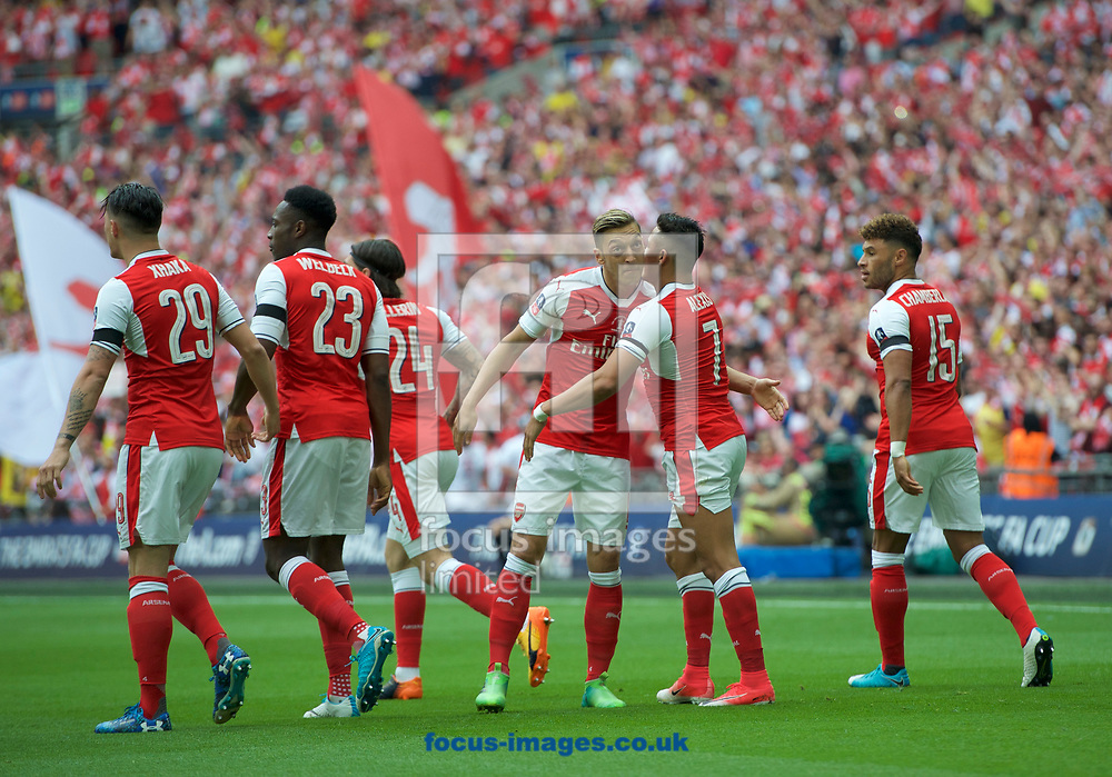 Alexis Sanchez of Arsenal celebrates after scoring the opening goal with Mesut Ozil of Arsenal during the FA Cup Final at Wembley Stadium, London.<br /> Picture by Alan Stanford/Focus Images Ltd +44 7915 056117<br /> 27/05/2017