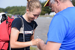Cecilie Uttrup Ludwig signs an autograph at Grand Prix de Plouay Lorient Agglomération a 121.5 km road race in Plouay, France on August 26, 2017. (Photo by Sean Robinson/Velofocus)