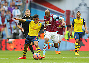 Arsenal's Alexis Sánchez battles with the ball during the The FA Cup match between Arsenal and Aston Villa at Wembley Stadium, London, England on 30 May 2015. Photo by Phil Duncan.