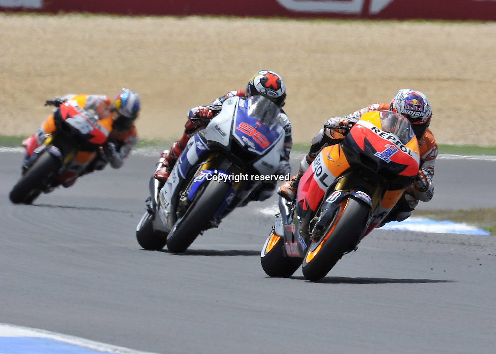 06.05.2012. Estoril, Portugal.  Motorcyle Grand Prix of Estoril.   Photo Casey Stoner leads the field directly ahead of Jorge Lorenzo and Dani Pedrosa