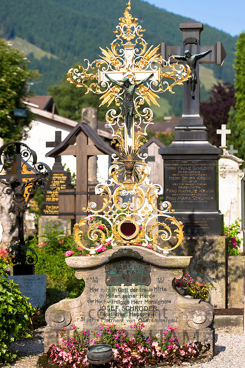 Crucifix of Jesus Christ  in village graveyard of Church of St Peter and Paul in Oberammergau in Upper Bavaria, Germany