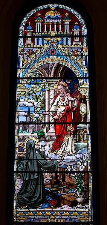Stained glass image representing apparition of the Sacred Heart of Jesus to St. Margaret Mary Alacoque. (Sam Lucero photo)