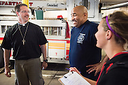 The Rev. Steven Schave, director of LCMS Urban & Inner-City Ministry (left) and Darrian Doederlein from the 2014 Youth Corps pilot project, talk to Marc Howard, a firefighter at the Philadelphia Fire Department, as the two visit a fire station near Shepherd of the City Lutheran Church on Tuesday, August 12, 2014, in Philadelphia, Pa. They were part of a Gospel Seeds session held during the event. LCMS Communications/Erik M. Lunsford