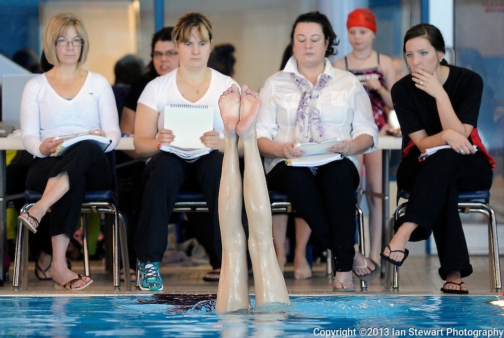Judges watch a competitor in the figures portion during the Synchro Yukon Championships in Whitehorse, Yukon.
