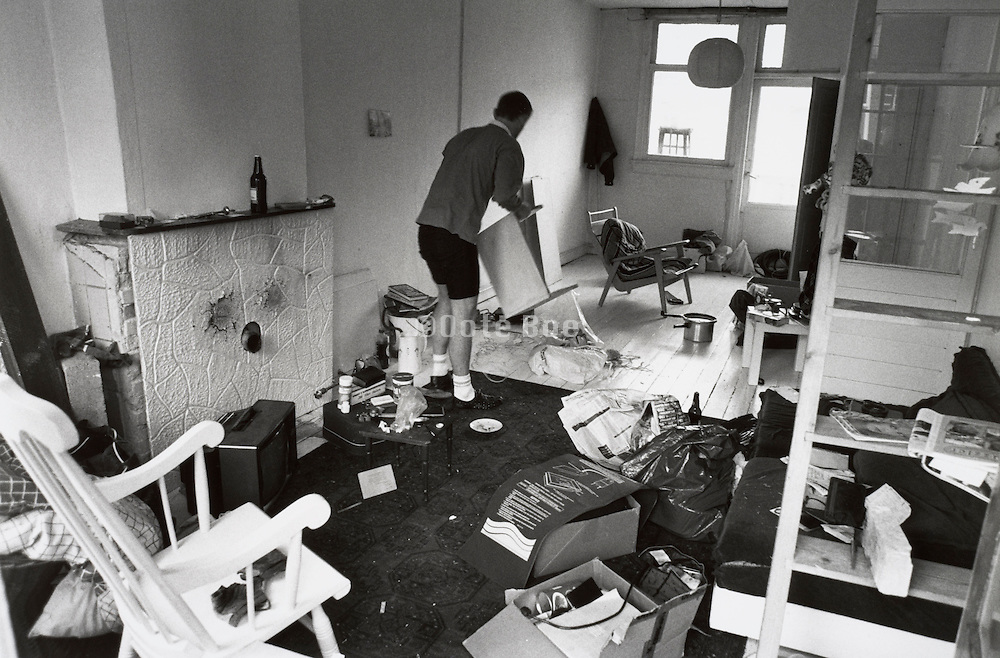 A man packing his belongings in boxes