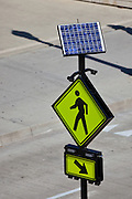 Solar powered pedestrian walk sign on Monroe Street in Chicago, IL, USA.