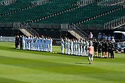 Hampshire and Somerset stand in a line for a minutes silence for the victims of the Manchester bombing during the Specsavers County Champ Div 1 match between Somerset County Cricket Club and Hampshire County Cricket Club at the Cooper Associates County Ground, Taunton, United Kingdom on 26 May 2017. Photo by Graham Hunt.