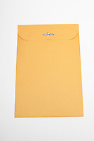 Brown envelope on white background