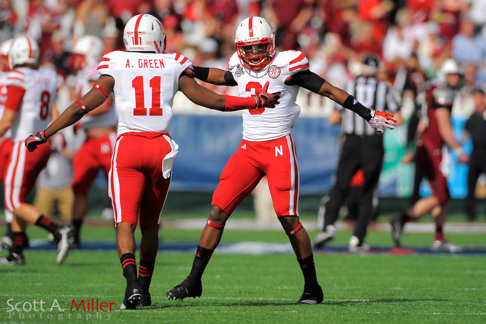 Nebraska Cornhuskers safety Daimion Stafford (3) and cornerback Andrew Green (11) celebrate during the Capital One Bowl against the South Carolina Gamecocks at Florida Citrus Bowl on Jan. 2, 2012 in Orlando, Fla. South Carolina won 30-13...©2012 Scott A. Miller