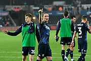 Luke Ayling (2)  of Leeds United acknowleges the Leeds fans after a 2-2 draw during the EFL Sky Bet Championship match between Swansea City and Leeds United at the Liberty Stadium, Swansea, Wales on 21 August 2018.