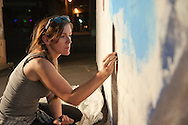 Sarah Terrell works on her mural late in the evening of August 6, 2016 during the Freak Alley Gallery sixth annual mural event in downtown Boise, Idaho.<br /> <br /> This was Sarah's sixth year of painting a mural in Freak Alley Gallery. This year's mural was a collaborative project between Sarah and her friend Mindy Field. Mindy wanted to do a anthropomorphic goat man and they decided a pirate would be fun. Mindy came up with the character and Sarah came up with the background that would work with it and they just went from there.<br /> <br /> Freak Alley Gallery's week long event provided an &quot;art-in-motion&quot; experience as it welcomed the public to watch artists work on their murals.