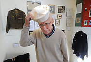 LOWER MAKEFIELD, PA - SEPTEMBER 20: Lester Gubbins, who has memorabilia in the display, tries on his old sailor cap during a fund raiser for Wounded Warriors September 20, 2014 at Spring Village at Floral Vale in Lower Makefield, Pennsylvania. (Photo by William Thomas Cain/Cain Images)