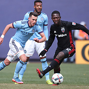 NEW YORK, NEW YORK - March 12:  Jack Harrison #11 of New York City FC challenged by Patrick Nyarko #12 of D.C. United during the NYCFC Vs D.C. United regular season MLS game at Yankee Stadium on March 12, 2017 in New York City. (Photo by Tim Clayton/Corbis via Getty Images)