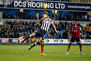 Millwall defender Sid Nelson (15) heading ball in box during the EFL Sky Bet League 1 match between Millwall and Shrewsbury Town at The Den, London, England on 10 December 2016. Photo by Matthew Redman.