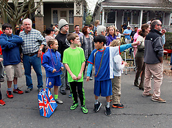 15 Feb 2015. New Orleans, Louisiana.<br /> Mardi Gras. Ben, Connor  and Jesse catching beads at The Krewe of Thoth.<br /> Photo; Charlie Varley/varleypix.com