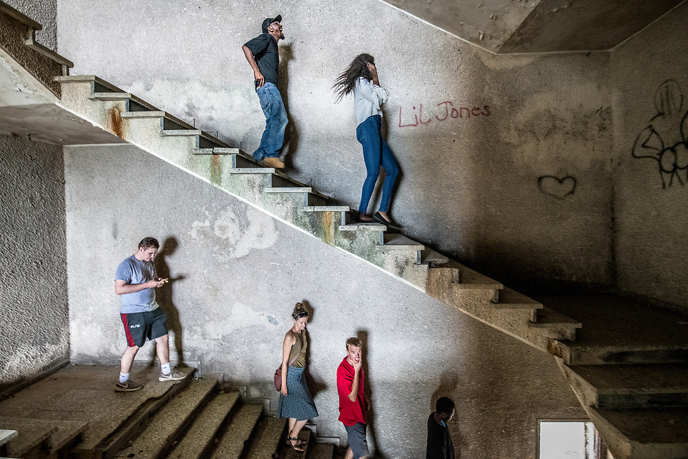 People walk down the stairs of the abandoned Ducor Hotel, once the most prominent hotels in Monrovia, Liberia