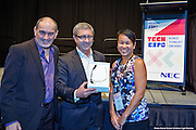 Glenn Irvine from Google Enterprises with Greg Vincent from Mix FM presents June Chin winner of the Google glass competition at the ICTCNT Business Technology Exhibition & Conference . Darwin Convention Centre. 3 September 2014 Darwin. Photo Shane Eecen