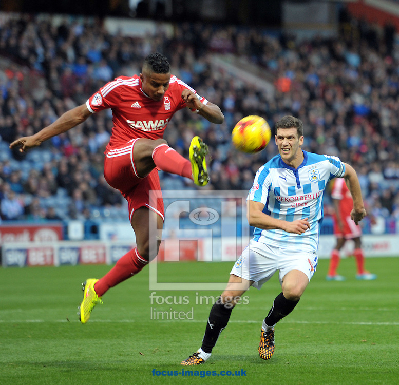 Mark Hudson of Huddersfield Town is beaten to the ball by Michael Mancienne of Nottingham Forest during the Sky Bet Championship match at the John Smiths Stadium, Huddersfield<br /> Picture by Graham Crowther/Focus Images Ltd +44 7763 140036<br /> 01/11/2014