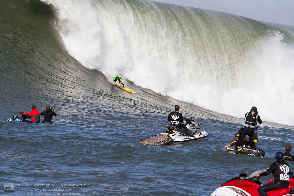 A surfer at the 2010 Mavericks Surf Contest wipes out on a giant wave - Half Moon Bay, California - February 13, 2010